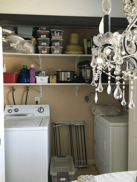 laundry room dreams and plans brick wall, closed storage, sorting hampers, hanging drying racks, art (8)