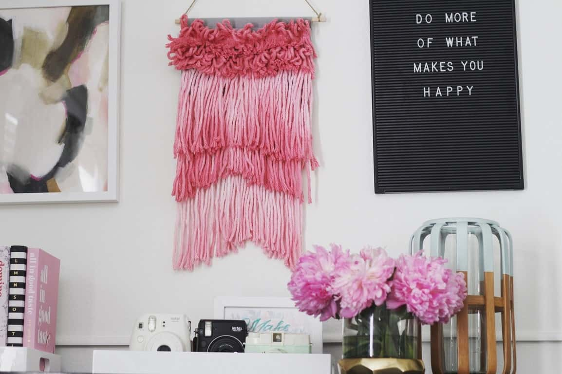 how to easily make a woven wall hanging from a mop head on a budget